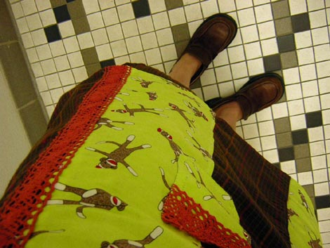 my sock monkey skirt, with bathroom tile